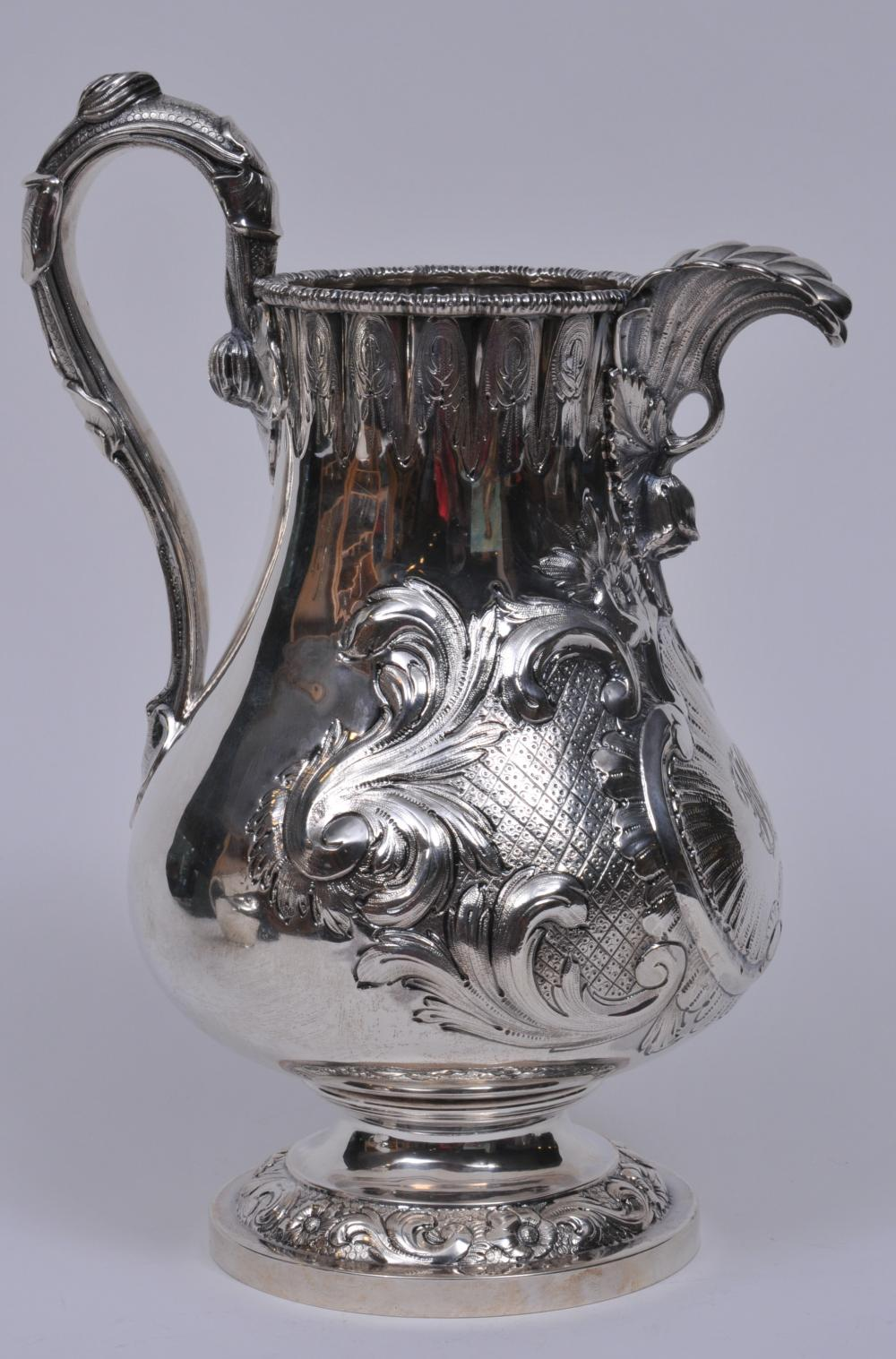 """Early Tiffany & Co. makers. Late """"Tiffany-Young-Ellis"""" large ornate water pitcher. Large acanthus leaf spout. Leaf and vine decorated handle. Leaf-quilted-cartouche decorated body. Monogrammed. Inscription on base rim. 12-1/2"""" high.  37.8 ozt. Good c"""