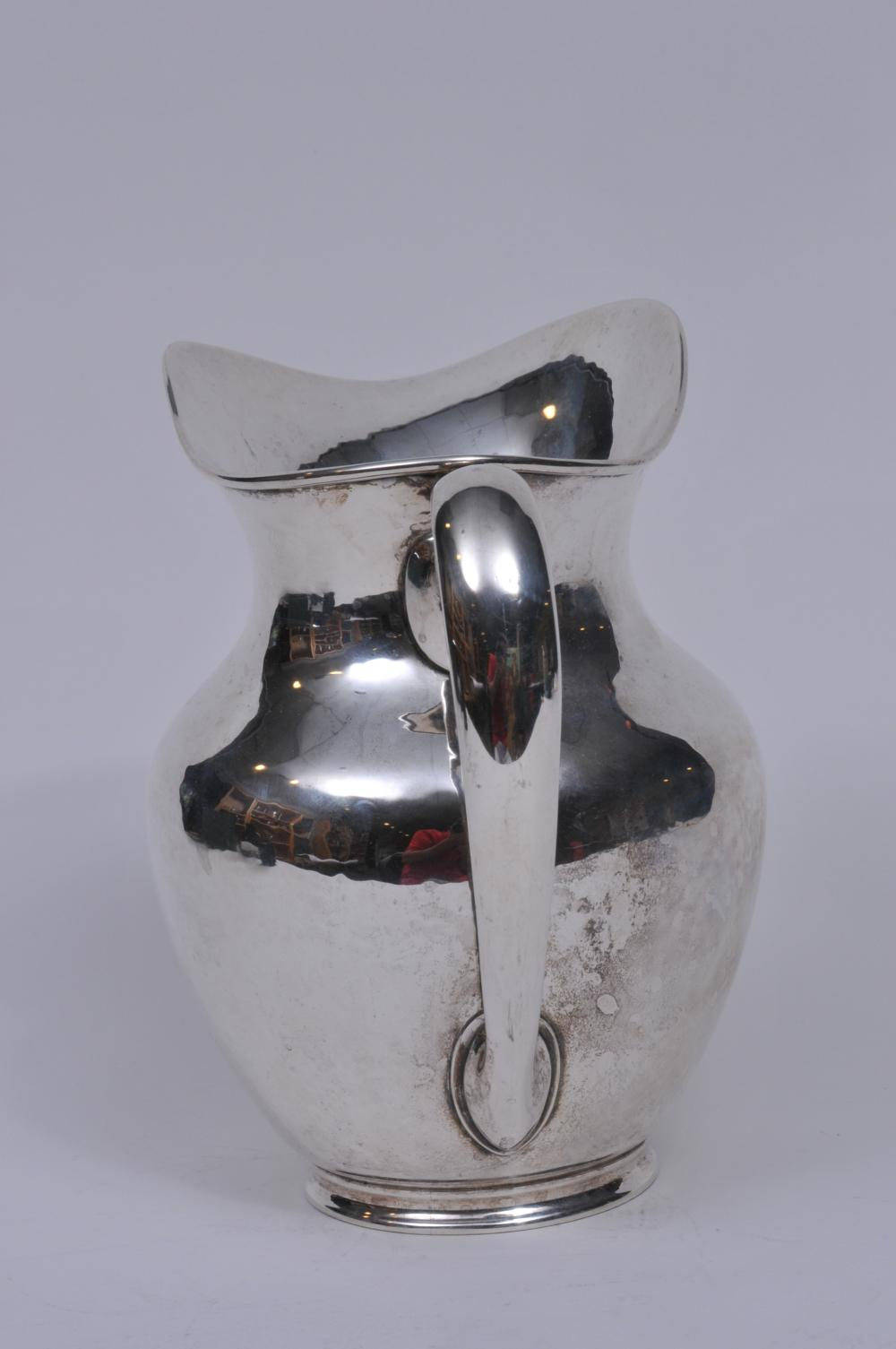"""Lot 13: Frederick J.R. Gyllenberg makers sterling silver Arts and Crafts pitcher. 8-1/4"""" high. Good condition. 29.2 ozt."""