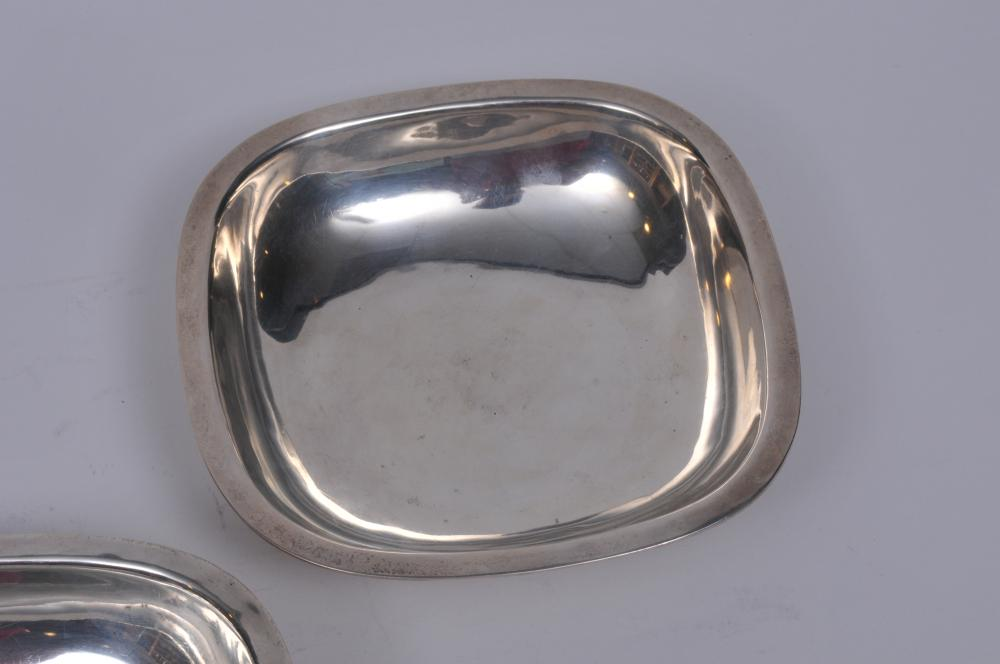 """Lot 22: Arthur Stone. Pair of sterling silver Arts and Crafts low square bowls with flat rims. 6-1/4"""" square. 1-1/2"""" high. Good condition. Light scratches. 17.9 ozt"""