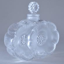 "Lot 23: Lalique glass. France. Figural flower form perfume bottle. Clear and frosted glass. Signed on base. 3-3/4"" wide."