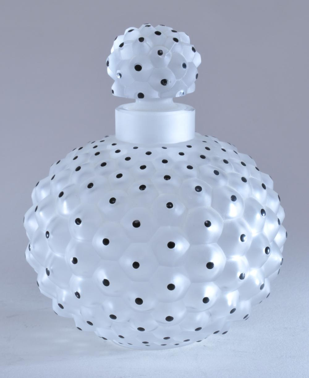 "Lot 26: Lalique glass. France. Frosted covered round perfume bottle with black dot decoration. Signed on base. Good condition. 4-3/4"" high."