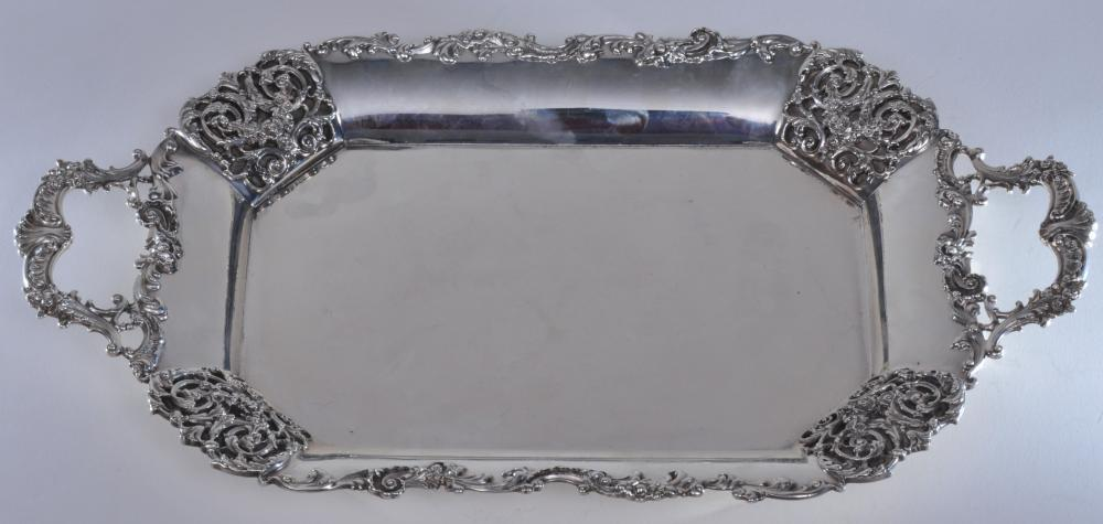 "Lot 28: Sterling silver two handle octagonal form tray with floral decorated panels and handles. F makers mark. 17"" long. 9-3/4"" wide. Small repairs to back of handle. 30.3 ozt."