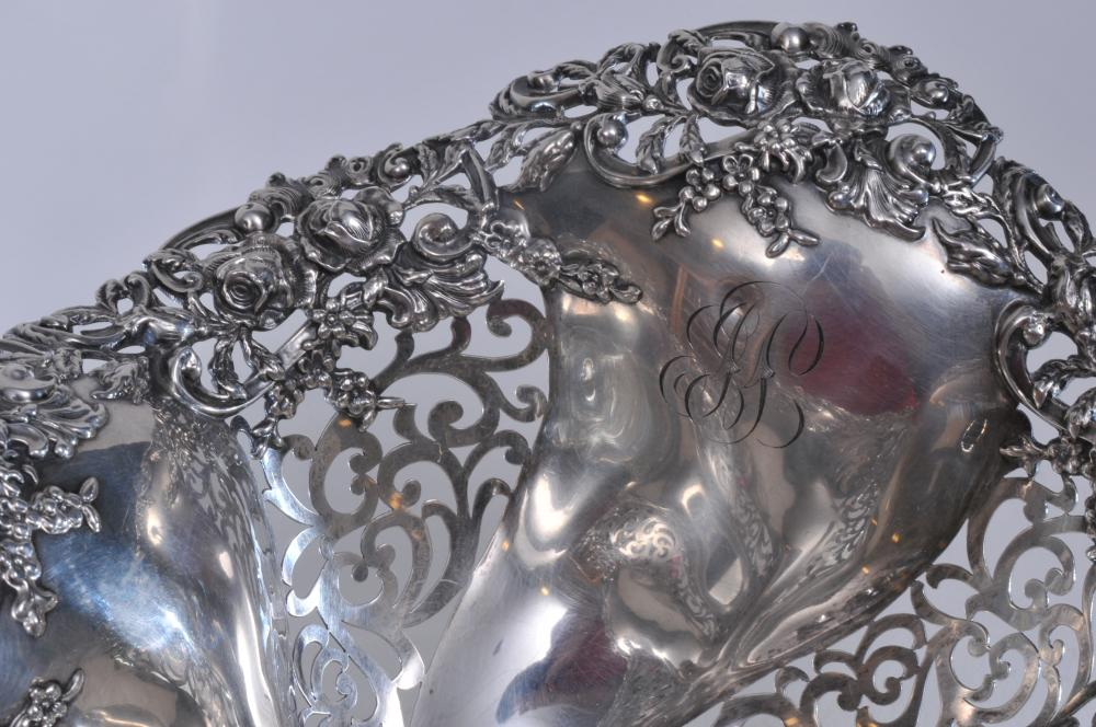 """Lot 29: Large Shreve Crump and Low sterling silver lobed form pierced decorated basket or bowl. Relief floral decoration. Floral pierced decorated feet. 12"""" wide. 6-3/4"""" high. 34.2 ozt. Good condition."""