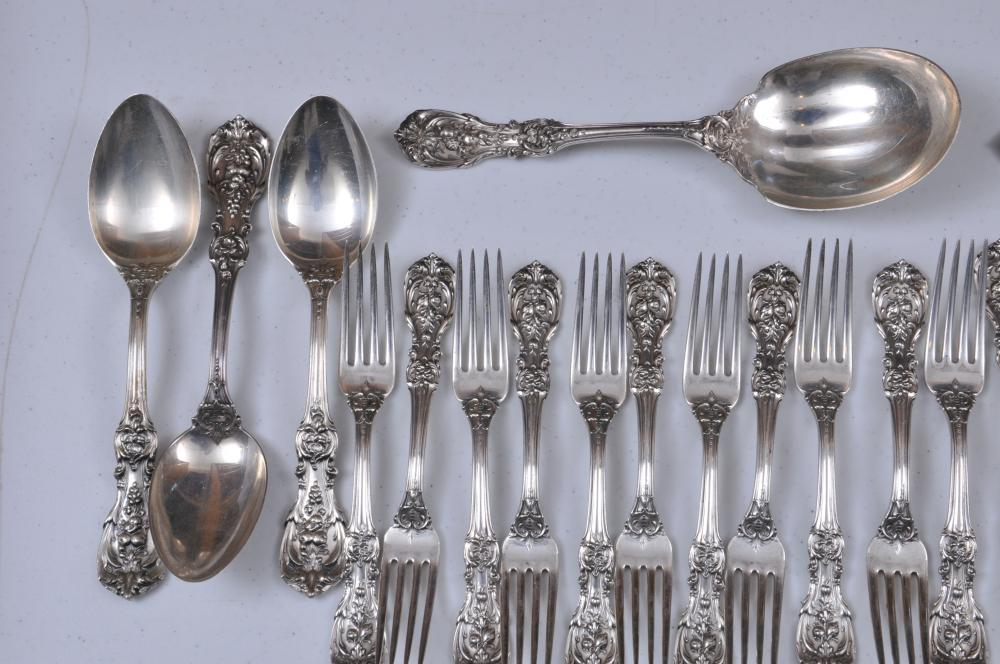 "Lot 32: Reed and Barton ""Francis I"" 89 piece sterling silver flatware set. Includes: (12) knives- 9-1/8"". (12) butter knives. (12) forks-7-1/4"". Old mark- (12) salad forks. Old mark (12) cream soup spoons- 5-7/8"". Old mark (23) teaspoons- 6"". Old mark- (3) s"