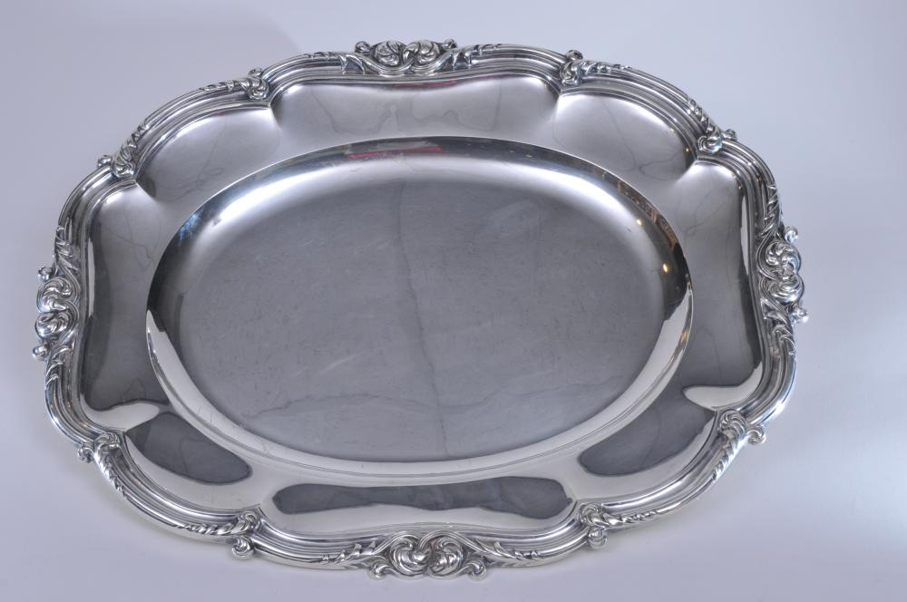 """Odiot large French silver cut corner rectangular tray with raised floral scroll decorated edge rim. Paneled body. Hallmarked on base. Scratches and slight dimples on tray center. Underside with slight dents, possibly in the making. 21-1/4"""" x 17-1/2""""."""