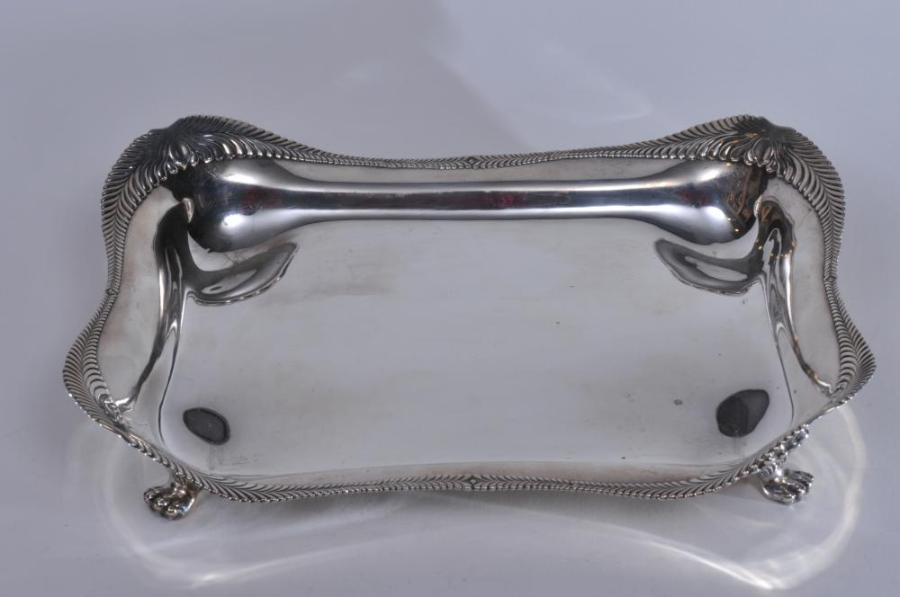 """Lot 34: Tiffany & Co. makers sterling silver Wave Edge pattern claw footed Asparagus tray and elaborate pierced design ball footed two handle liner and floral scroll decoration. Good condition. Tray- 13"""" x 10"""" x 2-1/2"""". Liner- 11-1/2"""" x 7-3/4"""". Total weight"""