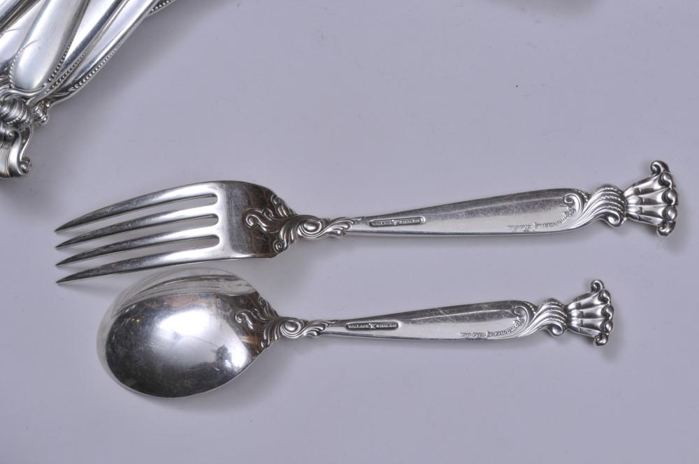 """Lot 35: Wallace """"Romance the Sea"""" sterling silver 153 piece flatware set. Includes: (35) teaspoons- 6"""". (23) forks- 7-1/4"""". (23) salad forks- 6-1/2"""". (23) cream soups- 6"""". (12) solid butter knives. (6) seafood forks- 5-1/2"""". (23) knives- 9"""". (1) serving spoo"""