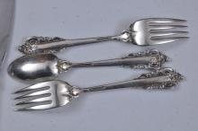 """Lot 41: Wallace """"Grand Baroque"""" sterling silver 52 piece partial flatware set. Includes: (12) forks- 7-3/8"""". (12) forks- 6-1/2"""". (12) solid butter knives- 6-1/4"""". (16) teapsoons- 6-1/4"""" . (12) knives- 8-7/8"""". Twelve handles at 1 ozt. Each. Total weight 85.5"""