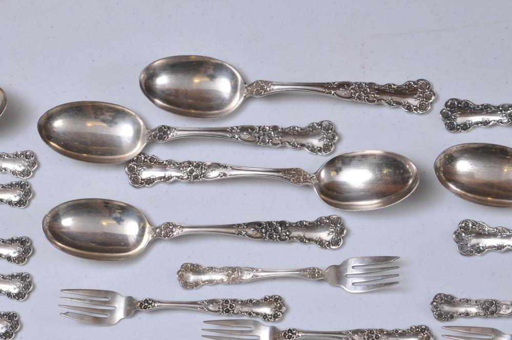 "Lot 42: Gorham ""Buttercup"" pattern sterling silver 147 piece partial flatware set. Includes: (17) cream soup spoons- 6-1/4"". ( 10) forks- 6-3/4"". (21) salad forks- 6-1/4"". (21) forks- 7-1/2"". (8) forks- 7"". (8) large serving spoons- 8-1/2"". (24) ice tea spoo"
