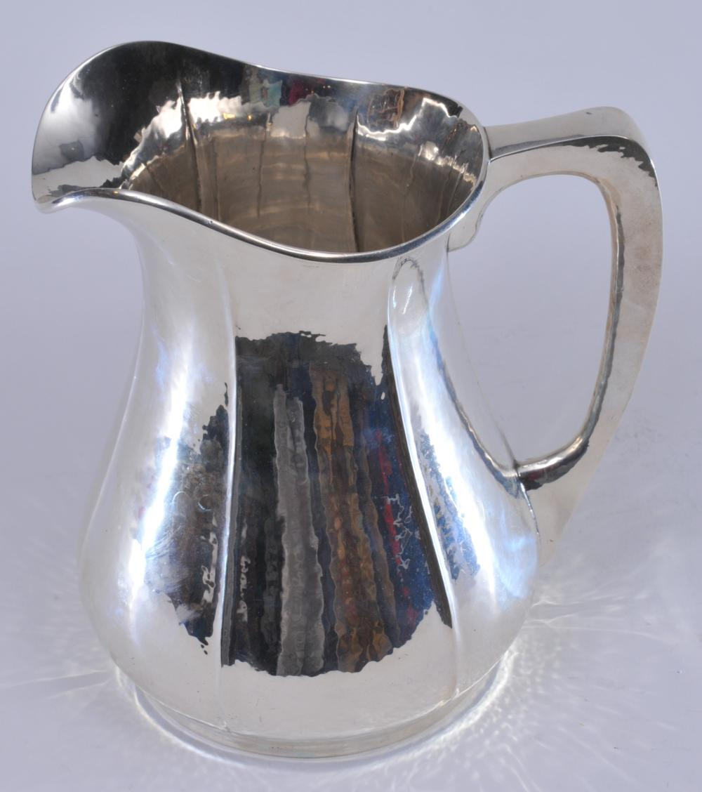 """The Randahl Shop makers hand wrought sterling silver Arts and Crafts pitcher. Paneled body with hand hammered surface. Good condition. 8-3/4"""" high. 25.8 ozt."""