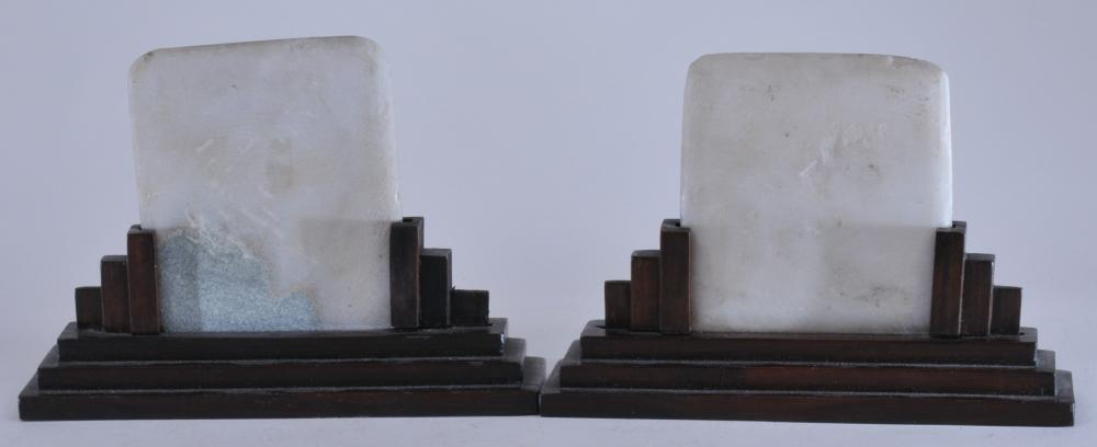 "Lot 46: Pair of dream stone panels. China. 20th century. Rosewood Art Deco style stands. Small chips to base of panel corners. 5"" x 7""."
