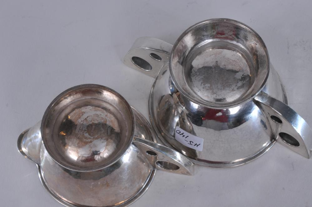 """Lot 47: Hand wrought Arts and Crafts sterling silver creamer and sugar with large pierced circle decorated handles and hand hammered surface. Marked """"Entirely Hand Wrought"""" on bases. Tiny """"as made"""" blemishes. Good condition. Creamer- 6-1/4"""" wide. 12.7 ozt."""