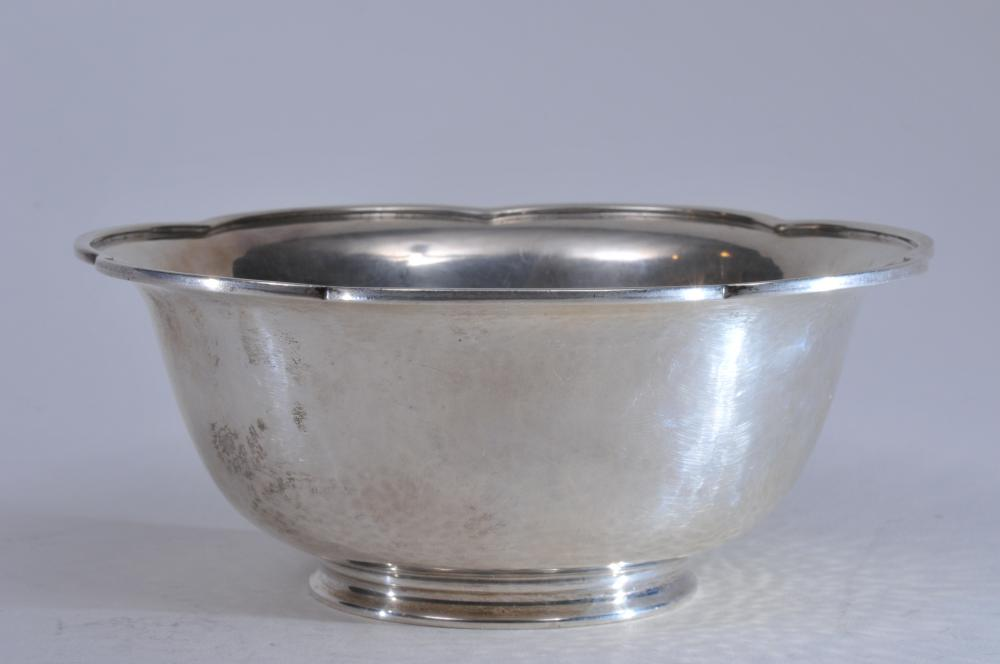 "Lot 51: Arthur Stone sterling silver Arts and Crafts scallop edge bowl with raised rim. Hand hammered surface. Light scratches. 6"" diameter. 2-1/2"" high. 9.2 ozt. Good condition."
