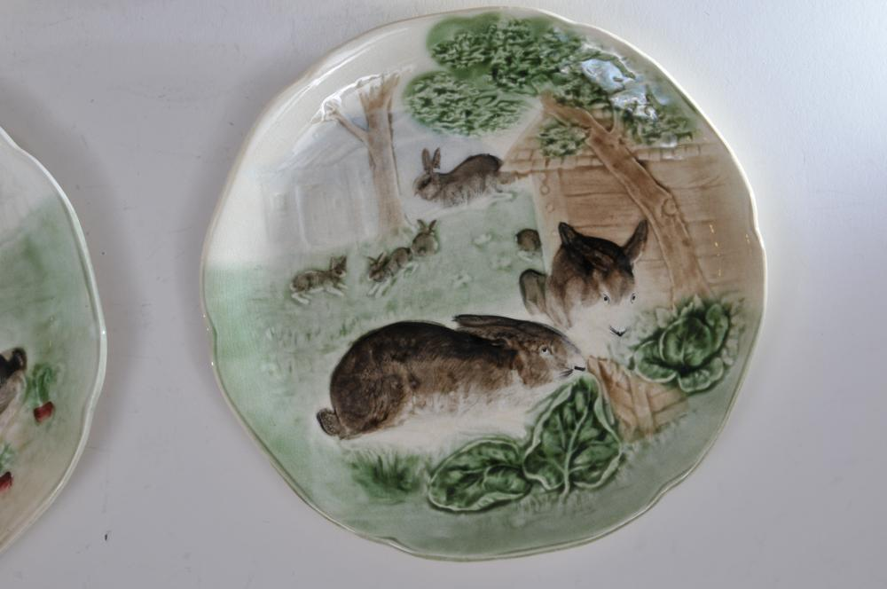 "Lot 52: Set of four early 20th century French Majolica pottery plates depicting various scenes of rabbits eating in a garden. Impressed mark on reverse. Good condition. Tiny as made defects. 8-3/4"" diameter."