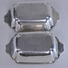 """Lot 56: Pair of Cellini Craft sterling silver Arts and Crafts handled deep dishes. Hand hammered finish. 8-1/2"""" wide. 5-1/4"""" deep. 2-1/2"""" high. 20.9 ozt. Good condition."""