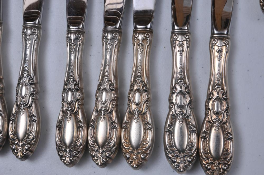 """Lot 53: Towle """"King Richard"""" sterling silver 152 piece flatware set. Includes: (9) Knives- 8-7/8"""". (15) Knives- 8-3/4"""". (23) Sterling silver blade butter knives- 5-1/2"""" long. (8) Table spoons- 7-1/4"""" long. (25) Teaspoons- 6"""" long. (24) Forks- 7-1/2"""". (27) S"""