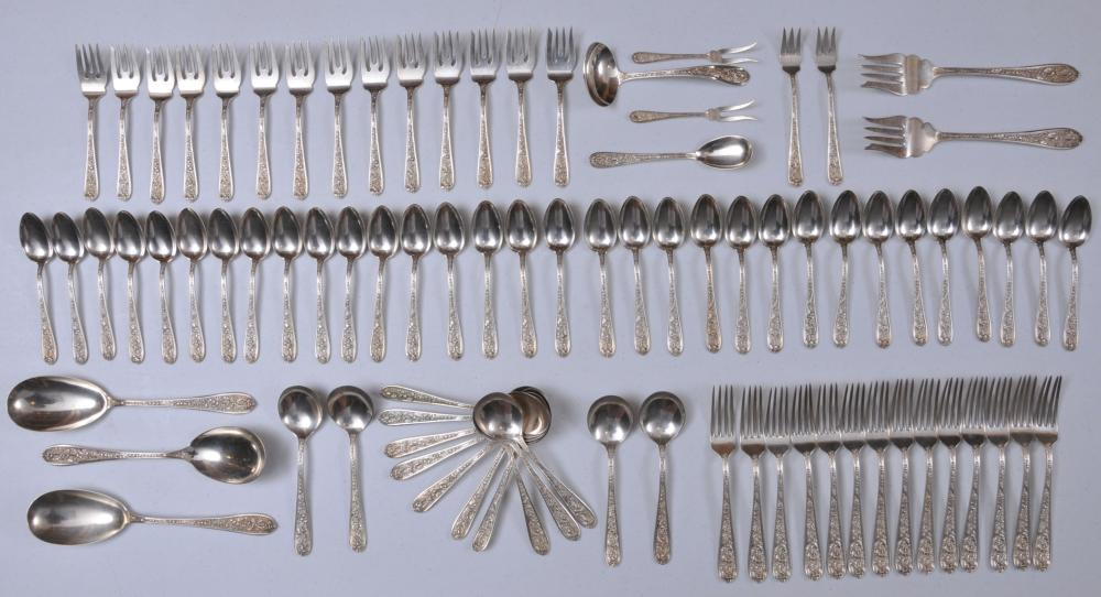 """Lot 61: Stieff sterling silver large floral repousse decorated 85 piece partial flatware set. Includes: (14) cream soup spoons- 6-1/2"""". (14) forks- 7-1/2"""". (14) salad forks- 6"""". (32) teaspoons- 6"""". (3) large serving spoons- 9-1/4"""". (2) large serving forks- 8"""