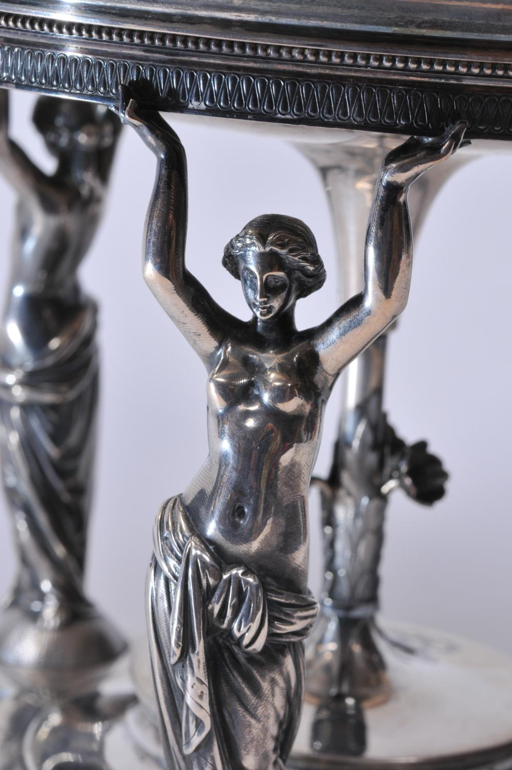Lot 63: Impressive Gorham Sterling Silver Victorian figural support tazza. Three full figure Classical women act as supports for the round dish top with chain decorated border and engraved medallion center. Central support with leaf and flower decoration. Da