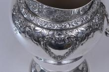 """Lot 62: Watson Company. Sterling silver large water pitcher. Shaped spout. Floral repousse and chased relief decoration. 11-1/2"""" high. Good condition. 31 ozt."""