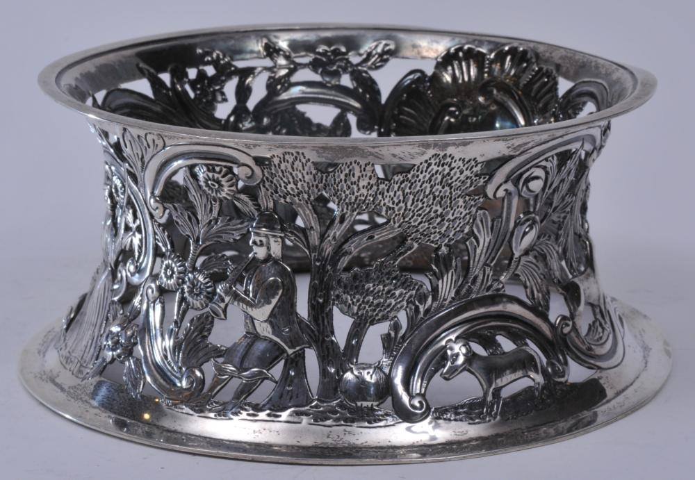18th century Irish Georgian silver dish stand. Ornate repousse decoration of figural sheppardess and man playing a musical instrument. Animals including sheep, goats, cow and a dog. Floral branch decoration. Large cartouche. Dublin- 1724-5 J? over F.
