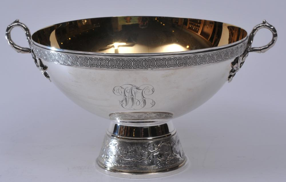 """Gorham sterling silver Victorian gilt lined two handled tazza. Leaf form applied handles. Asian Geometric border. Base with Chinoiserie landscape decorated scene with birds and figure. Dated 1875. Monogrammed. Good condition. 10-1/2"""" wide. 6"""" high."""