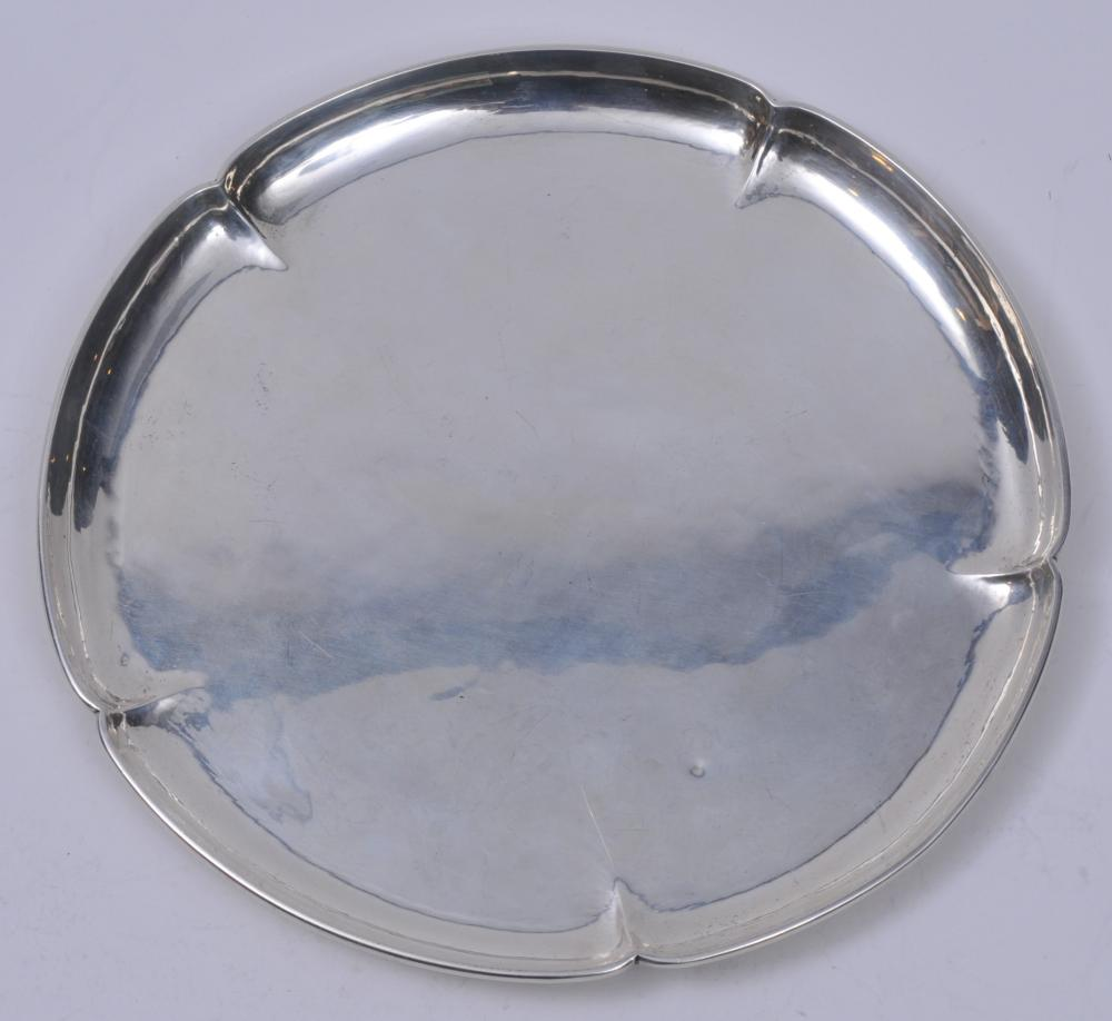 """The Kalo Shops Arts and Crafts sterling silver round tray with scalloped rim and pinched decoration. Light scratches. Two small dings. One slight crease. Inscribed on base. 9"""" diameter. Signed on base. 11.4 ozt."""