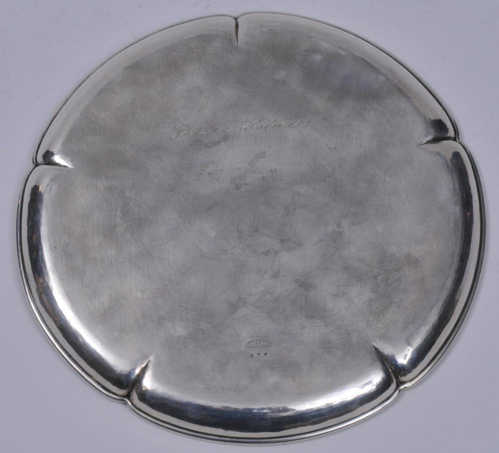 """Lot 70: The Kalo Shops Arts and Crafts sterling silver round tray with scalloped rim and pinched decoration. Light scratches. Two small dings. One slight crease. Inscribed on base. 9"""" diameter. Signed on base. 11.4 ozt."""