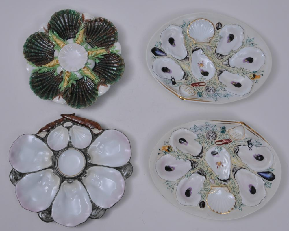 """Lot of four antique oyster plates. (1) Pair of Union Porcelain Works oval scallop form hand painted oyster plates. Marked on bases. Minor wear to some relief painted decoration. 10-1/4"""" x 7-3/4"""". (2) Hand painted eight section oyster plate. 9"""" x 10""""."""