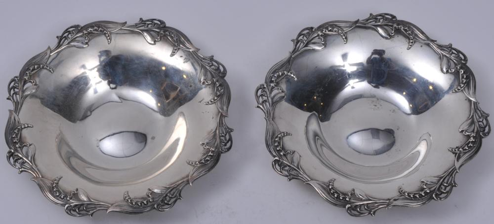 """Pair of Tiffany & Co. makers sterling silver round bowls. Raised floral bellflower pierced decorated rims. 7-3/4"""" diameter. 12.9 ozt."""