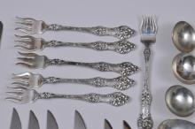 """Lot 80: Alvin Manufacturing Co. sterling silver """"Old Orange Blossom"""" pattern 67 piece partial flatware set. Includes: (12) cream soup spoons-6-7/8"""". (6) forks- 7-1/2"""". (6) forks- 6-3/4"""". (15) teaspoons- 5-3/4"""". (6) ice cream or fruit spoons- 5-3/4"""". (6) seaf"""