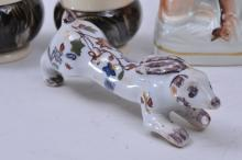 "Lot 79: Lot of four items. (1) Small antique Staffordshire pottery hound figure- 4"" high. (2) Small French Faience rabbit figure signed Bayeux. 4"" long. (3) Pair of English agate ware condiment pieces- one hinged pot and pepper pot. Patent mark on base. 2-1/"