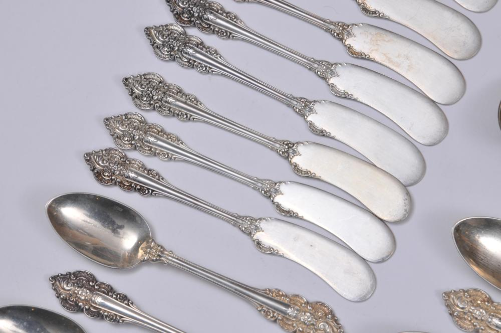 "Lot 82: Frank Whiting ""Botticelli"" pattern 72 piece flatware set. Includes: (12) knives- 9-1/4"". (12) solid butter knives- 6-1/4"". (12) salad forks- 6-1/2"". one fork with deep scratches on tines. (12) cream soup spoons- 6-1/8"". (12) large forks- 7-1/4"". (12)"