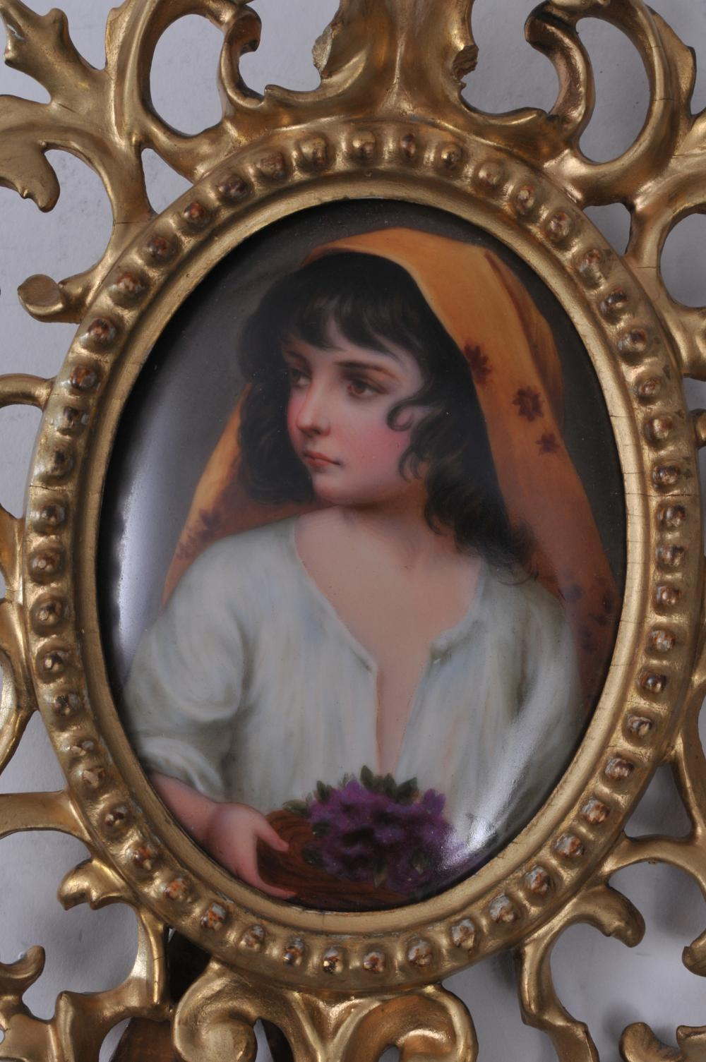 """Lot 90: 19th century Continental painting on porcelain framed plaque. Oval hand painted scene of a young girl holding flowers. Gilt carved wood frame. Touch up to gilt on frame. 10-1/2"""" overall size. Plaque- 4-1/2"""" x 3-1/4""""."""