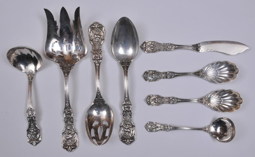 "Lot 98: Reed and Barton ""Francis I"" sterling silver. Lot of eight serving pieces. Includes: (1) pierced bowl serving spoon- 8-1/4"". (1) large serving fork- 9-1/4"". (1) serving spoon- 8-1/4"". (1) ladle- 6-1/4"". (1) cheese spreader- 7"". (1) small ladle- 5-1/2"""