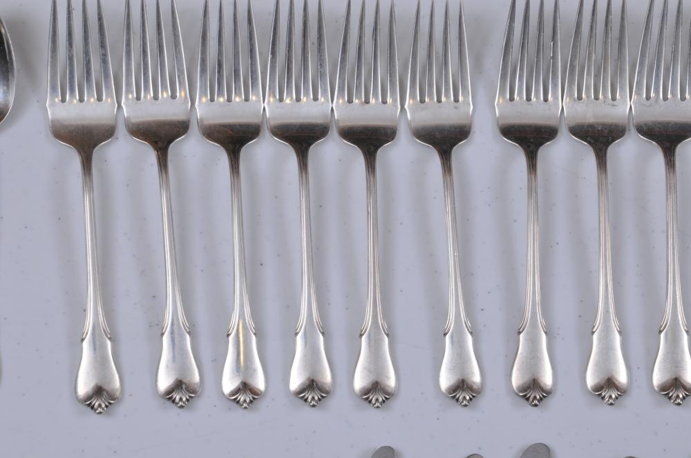 "Lot 99: Wallace ""Grand Colonial"" pattern sterling silver 60 piece flatware set. Includes: (12) forks- 7-3/4"" (12) knives- 9-3/4"". (12) cream soup spoons- 6"". (12) teaspoons- 6"". (12) forks- 6-1/2"". Twelve knife handles at .5 ozt each. Total weight- 65.1 ozt."