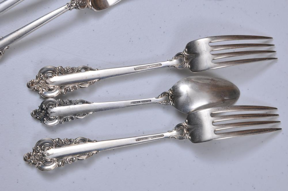 """Lot 101: Wallace """"Grand Baroque"""" sterling silver flatware pieces. Includes: (10) forks- 7-1/2"""". (10) forks- 6-1/2"""". (10) teaspoons- 6-1/4"""". Total weight- 48.9 ozt."""