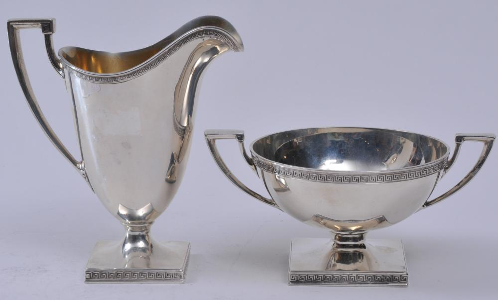 """Gorham sterling silver sugar and creamer. Classical form with Greek Key borders. Gilt interior on creamer. Creamer- 5-3/4"""" high.  14.6 ozt. Total weight. Good condition."""