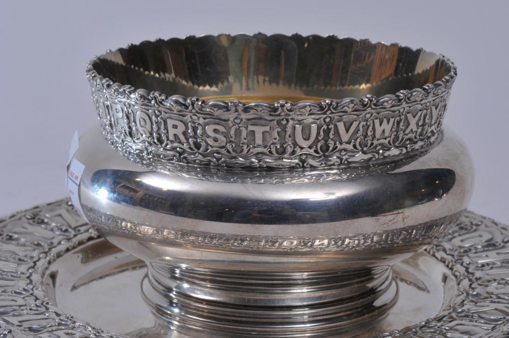 """Lot 110: Black Starr & Frost makers heavy sterling silver two piece child's set. Ornate alphabet plate. """"Mary"""". 8"""" diameter alphabet decorated bowl. """"Mary"""". Gilt lined. 5"""" diameter. Good condition. 25 ozt."""