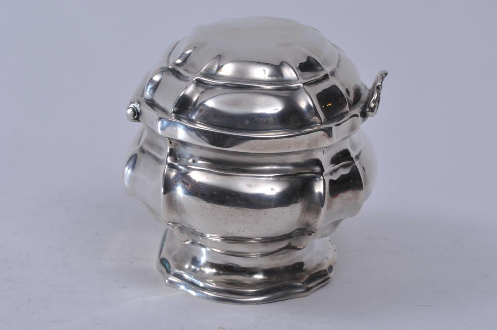 "Lot 108: 19th century Augsburg silver covered box or tea caddy. Octagonal lobed form. Hall marked on base. 4-1/2"" wide. 7.0 ozt. Good condition."