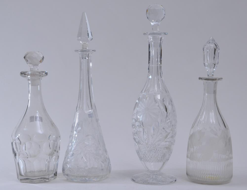 """Four clear glass decanters. Three cut glass decanters. One pressed glass decanter. 12"""" to 16-1/2"""" high. One stopper is broken."""