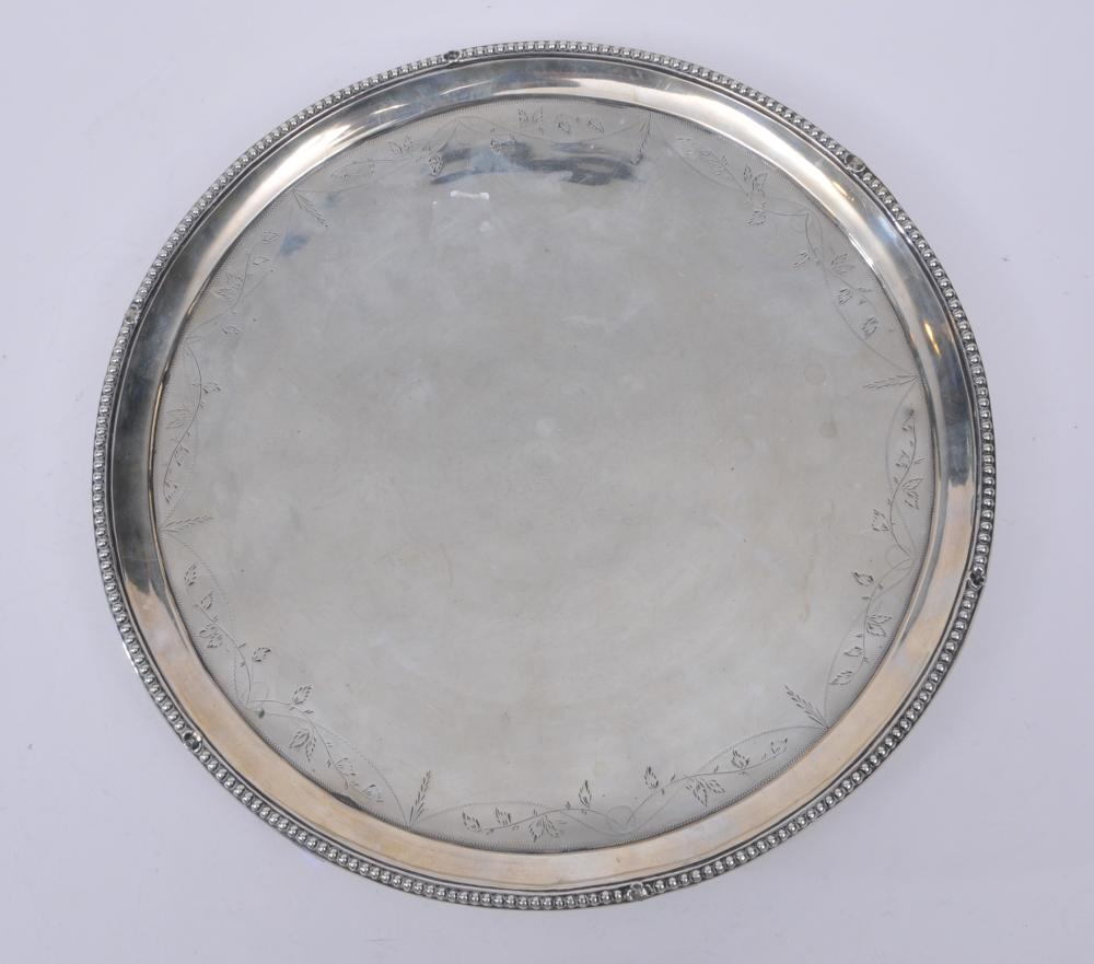 """Early 19th century large footed silver tray. Beaded border. Engraved vine decorated scroll feet. Hallmarked on rim. Slight dents on side rim. 13"""" diameter.  30.8 ozt."""