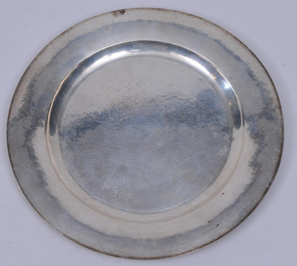 """Kalo sterling silver Arts and Crafts hand wrought large hand hammered round plate. 1923 inscription on base. Good condition. Light scratches. 11"""" diameter. 18.8 ozt."""