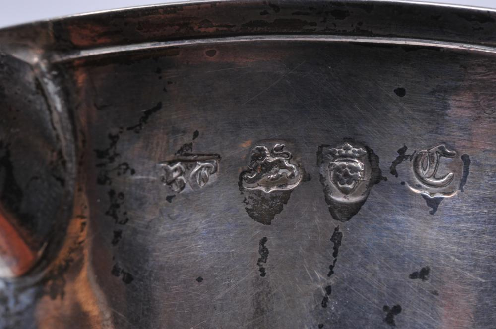 "Lot 113: 18th century English Georgian sterling silver two handle cup. Monogrammed I.H. on handle. Later monogram on front. Hallmarked at body near handle. Good condition. London 1758-9. Rims have slight dents. 4-3/4"". Total weight- 10.3 ozt."