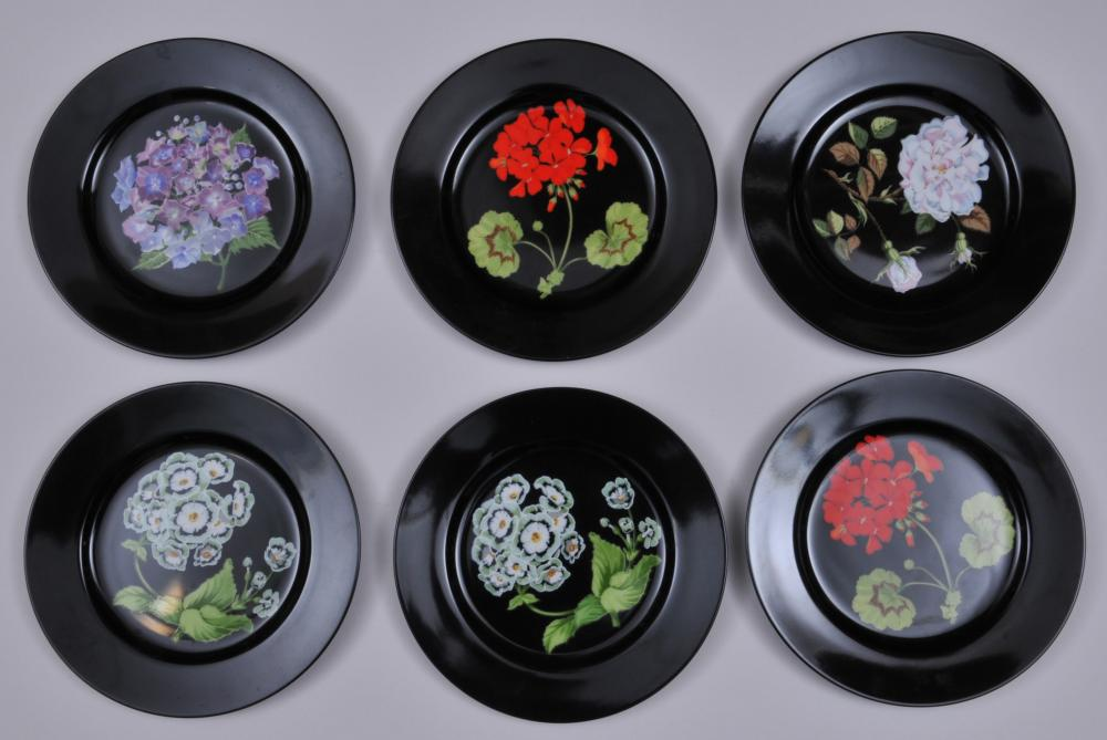 """Six Tiffany & Co black ground """"Mrs. Delany's Flowers"""" pattern porcleain plates by Sybil Connolly. 7-3/4"""" diameter."""