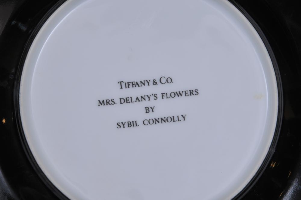 """Lot 127: Six Tiffany & Co black ground """"Mrs. Delany's Flowers"""" pattern porcleain plates by Sybil Connolly. 7-3/4"""" diameter."""
