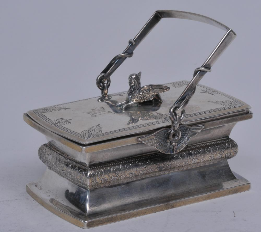 Rare Gorham Victorian sterling silver Egyptian Revival Issis pattern unusual small handled tea caddy with gilt interior. Winged handle supports. Figural winged Issis finial. Leaf and vine decoration. Monogrammed. Several tiny dings on body. Good cris