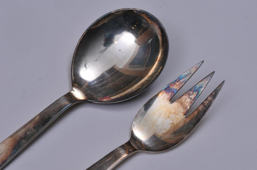 """Lot 130: COHR. Denmark. Sterling silver Mid Century Modern design two piece salad set. Jensen style decorated handles. 8-1/8"""" long. 5.8 ozt."""