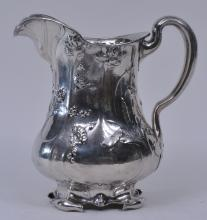 """Lot 141: Gorham Martele large sterling silver pitcher. Art Nouveau floral and leaf decoration with rolled leaf form feet. Retailed by Spaudling and Co. Chicago. 9-3/8"""" high. 44.1 ozt."""