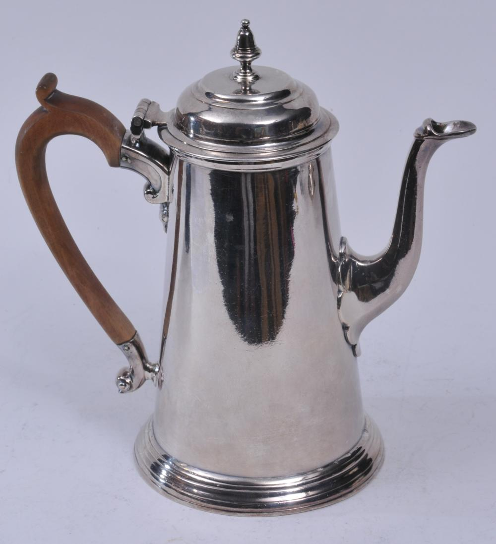 "Lot 179: 18th century English Georgian sterling silver Lighthouse form coffee pot. Turned wood handle. London 1736-7. R.G. or R.L. makers mark. 9"" high. Marked on base. 31.5 ozt."