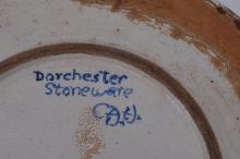 "Lot 126: Large Dorchester Pottery round dish. Palm tree decoration. Glaze skips and loss. 13"" diameter."